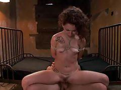Curly brunette gets banged hard in the dungeon