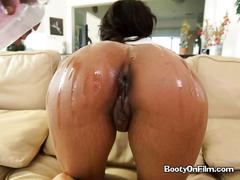 Ebony chick shows her booty and sucks cock