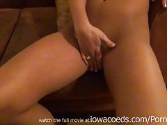 Sexy brunette rubs her sweet cunt and provokes