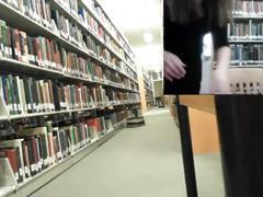 Horny slut masturbating in the library