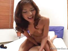 Japanese milf with hairy cunt rides hard cock.