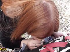 Sexy redhead gives great head in the forest