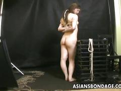 Hairy japanese babe treated to a bdsm rope session