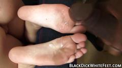Hottie gives cock footjob