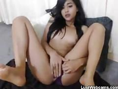 Sexy asian teen girl dildoing her pussy on webcam