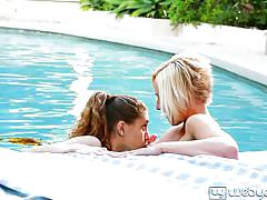 Lesbian lovers love it doing by the swimming area