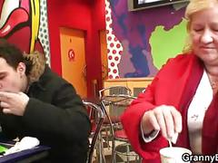 Young guy picks up huge old grandma in cafe