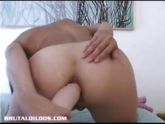 Asian student stretches her hot ass with a brutal dildo