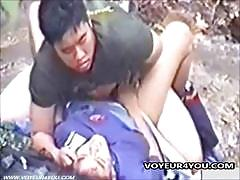 An asian couple fucking in the forest