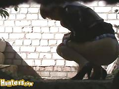 Innocent amateur chicks caught peeing outdoors