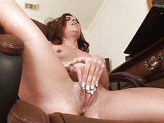 Mature with pierced nipples strokes her pussy
