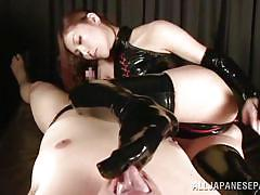 Asian babe in kinky outfit blows a dick