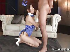 Japanese in kinky outfit sucks dick