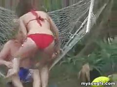 Brunette girlfriend having outdoor sex in hammock.