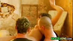 Brazilian slut in a threesome outdoors