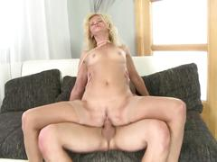 Mature slim mom seduces young boy
