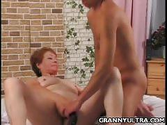 Young stud bangs a horny granny very hard