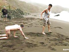 Blindfolded guy gets fucked on the shore