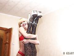 Extremely tall giantess playing with petite blonde
