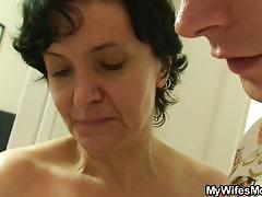 Mature slut takes a shower and enjoys a young cock