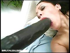 Lisa struggles inserting massive dildo on her hole
