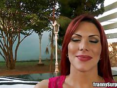Sexy redhead tranny blows him well