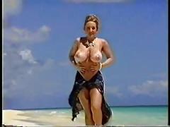 Danni ashe teases on the beach