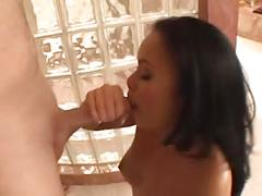Asian girl uses hand and mouth to coax a load