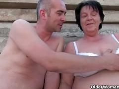 Chubby grandma with rock hard nipples gets fucked outdoors