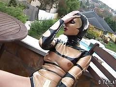 Kinky blonde in latex outdoors