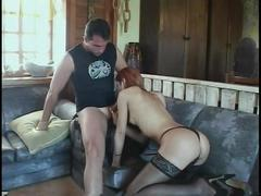 Redhead shemale gets fucked in the ass after sucking dick on the sofa