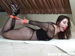 Angel corte bound with orange rope and gagged