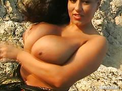 Aneta buena with massive tits teasing on the rocks