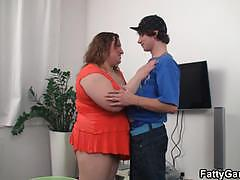 Fatty brunette milf sucks and fucks a young cock.