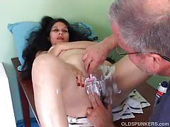 Old doctor shaves a mature woman's pussy