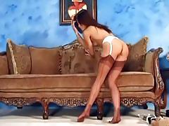 Sexy brunette teasing and fingering in stockings