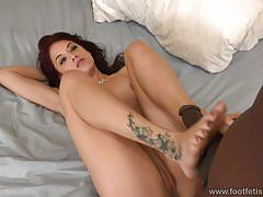 Onyx takes in that big black cock and gives a footjob