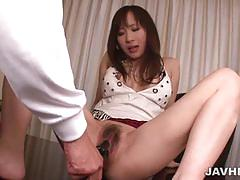 Japanese brunette gets dildoed before sucking cock