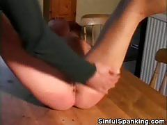 Mature wife gets her nice ass spanked by her man.