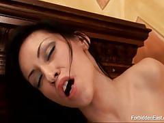 Brunette asian lesbian babes licks each other.
