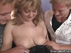 Two horny dudes nail a mature lady