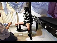 Hot slave girl gets tied up wearing a latex suit
