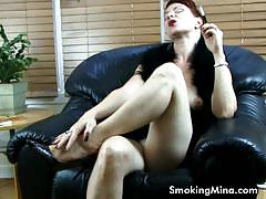 Redhead milf mina gorey smokes and poses