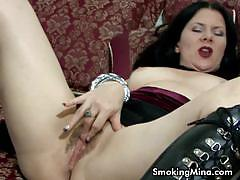 Brunette slut smokes and rubs her sweet cunt