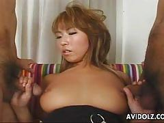 Busty japanese slut plays with three hard cocks