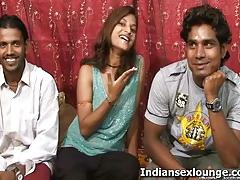 Two indian guys play with a girl's big boobs