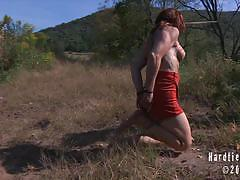 Sweaty tied up redhead catherine gets tortured.