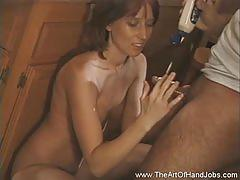 Busty brunette gives her man an amazing handjob
