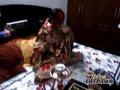 Shilpa bhabhi smoking at a hookah and posing