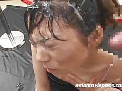 Asian girl gets her hair soaking wet with cum